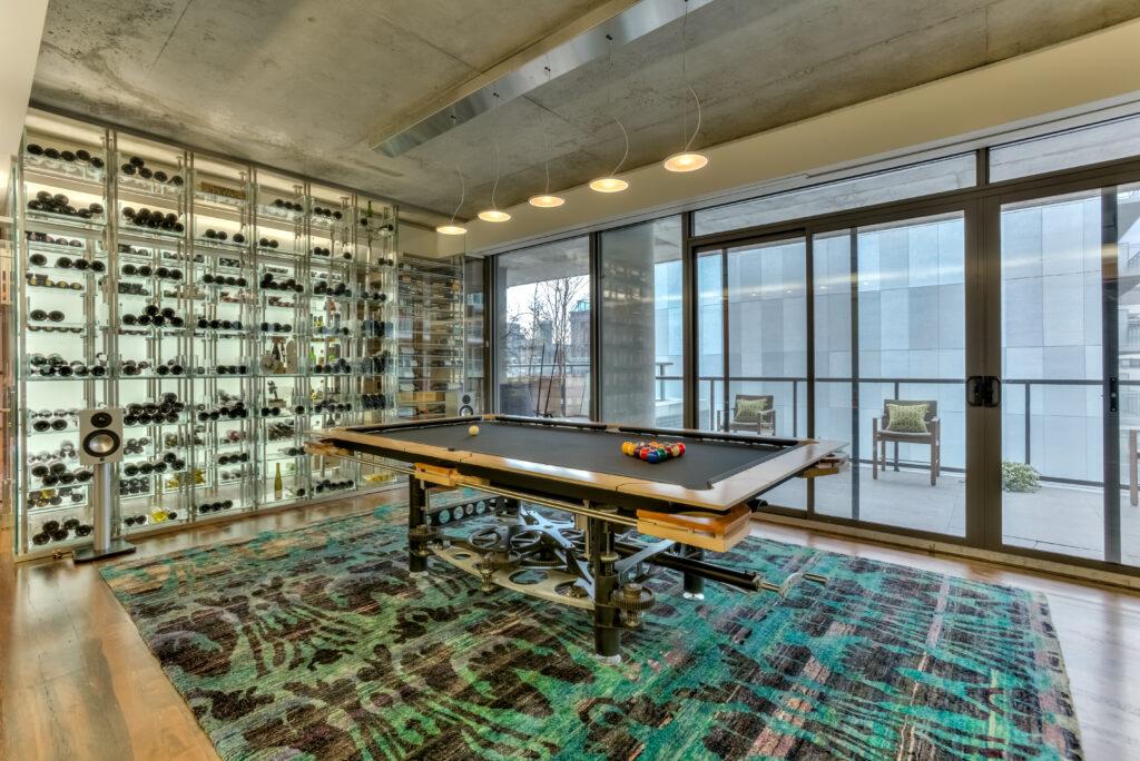 Pool table and wine rack wall