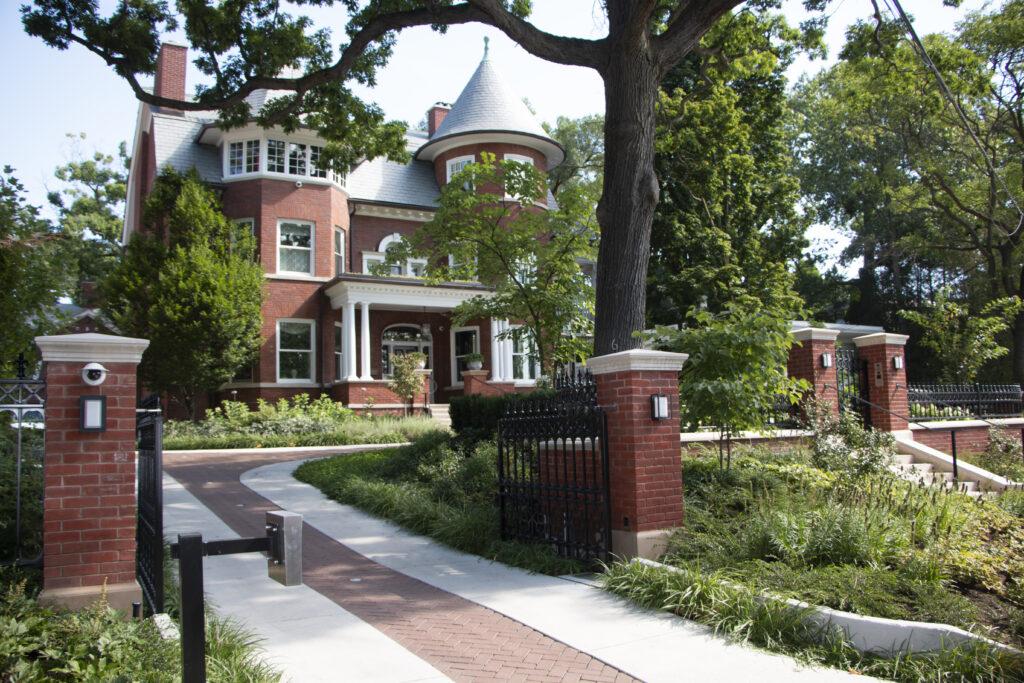 Smart home exterior with gate and intercom
