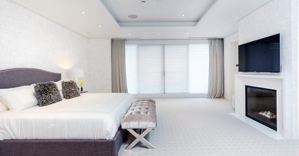 Bedroom with motorized window coverings